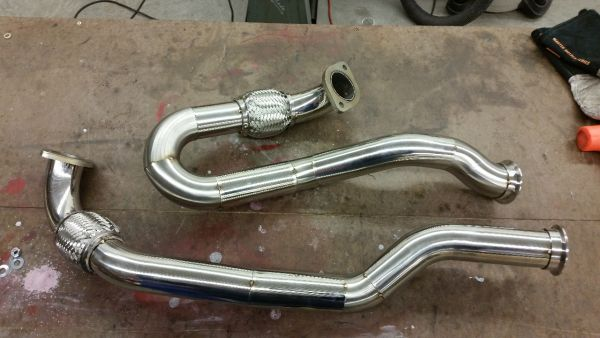 Dual exhaust pipes tack welded.