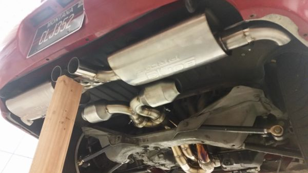 Mufflers with gusset plate, X-pipe, and catalytic converters.